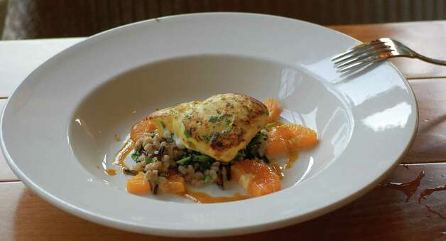A citrus and fish dish at Lake Austin Spa Resort. Photo: Melissa Ward Aguilar