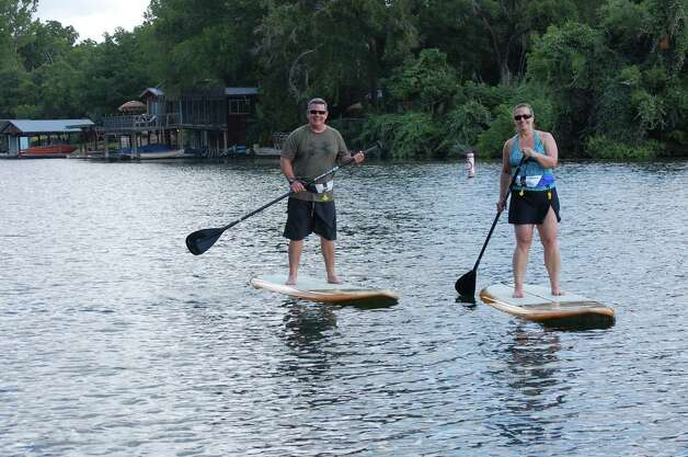 Bryan and Laura try out the paddleboards at Lake Austin Spa Resort. Photo: Melissa Ward Aguilar