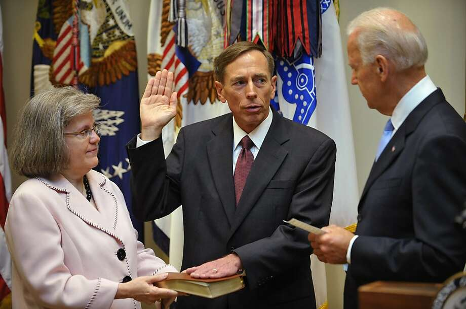 CIA Director David Petraeus, stands next to his wife, Holly, at his swearing-in ceremony. Petraeusresigned November 9, 2012from his post due to an extramarital affair, according to media reports. Photo: Mandel Ngan, AFP/Getty Images