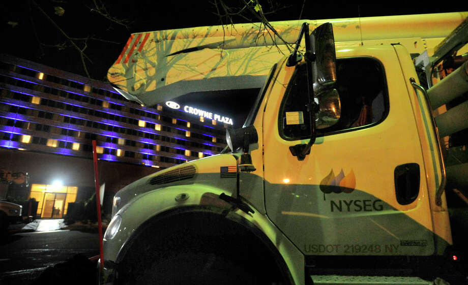 New York state utility trucks sit outside the Crowne Plaza Danbury on Thursday, Oct. 8, 2012. Photo: Jason Rearick / The News-Times