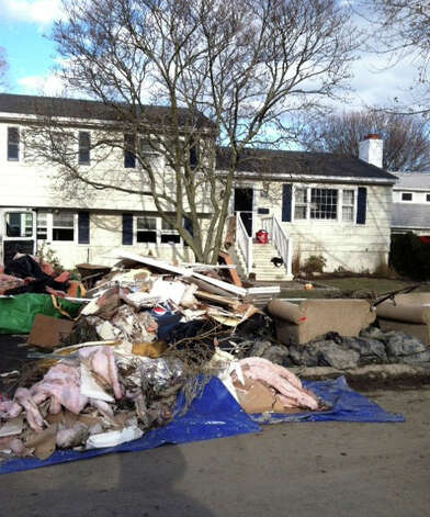 Kathy Niznansky's home following flooding caused by Sandy. Her daughter, Kelly,  has helped organize a community cleanup in the Fairfield Beach neighborhood this Sunday. Photo: Contributed Photo / Connecticut Post Contributed
