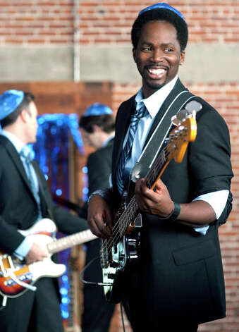 "Harold Perrineau costars on TBS' new comedy, "" Wedding Band, "" premiering Saturday. He already played the bass, but had to learn the cello, saxophone, keyboards and trombone for the series. (MCT) Photo: MCT, HO / MCT"