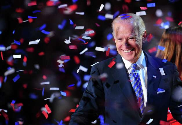 US Vice President Joe Biden celebrates on election night November 7, 2012 in Chicago, Illinois. Republican Presidential candidate Mitt Romney has conceded the race to US President Barack Obama.    AFP PHOTO / Robyn BeckROBYN BECK/AFP/Getty Images Photo: ROBYN BECK / AFP