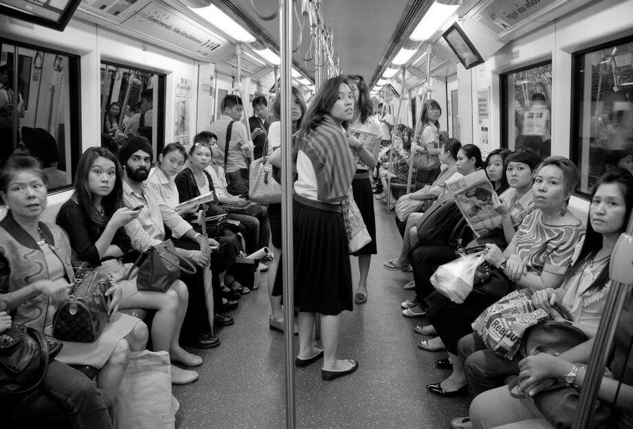 """Fried egg!"" Filmmaker and photographer Benz Thanachart documented subway riders' reactions to shouted exclamations in Thailand. For this photo, he shouted ""Fried egg!"" (Courtesy / Benz Thanachart)"