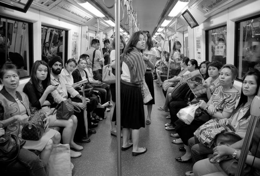 """Fried egg!"" Filmmaker and photographer Benz Thanachart documented subway riders' reaction"