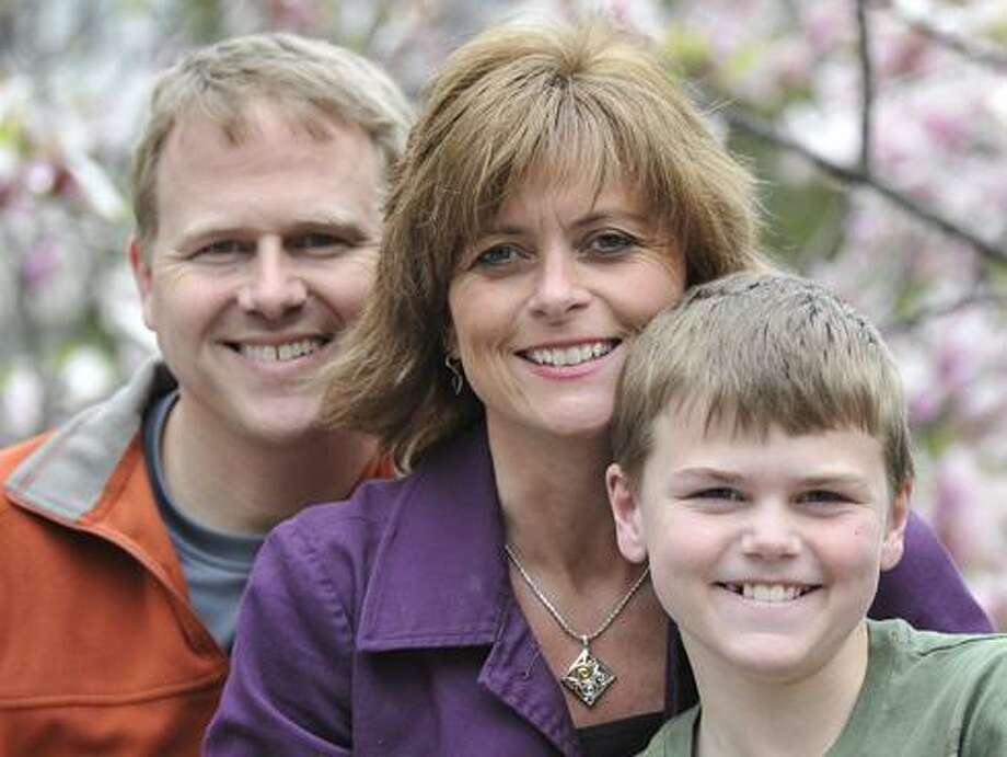 Pictured is Todd, Sonja and Colton Burpo. Todd Burpo (along with Lynn Vincent) wrote 'Heaven is for Real' about Colton's near-death experience during an emergency appendectomy. Photo: Courtesy Of Todd Burpo