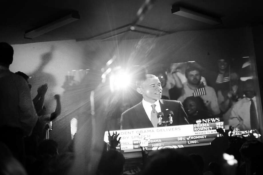 At an election party for the Democratic Party in San Francisco,  a crowd of Obama supporters watch as President Barack Obama gives his victory speech on Tuesday Nov. 6, 2012 in San Francisco, Calif.