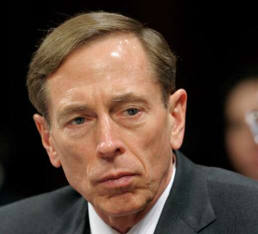 FILE - This Feb. 2, 2012 file photo shows CIA Director David Petraeus testifying on Capitol Hill in Washington. Petraeus has resigned because of an extramarital affair.  (AP Photo/Cliff Owen, File) Photo: Cliff Owen