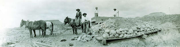 Copy photo, Oct. 19, 2012, of mine workers using an ore wagon at the Shafter, Tx. silver mine site. Photo: COURTESY PHOTO, San Antonio Express-News / San Antonio Express-News