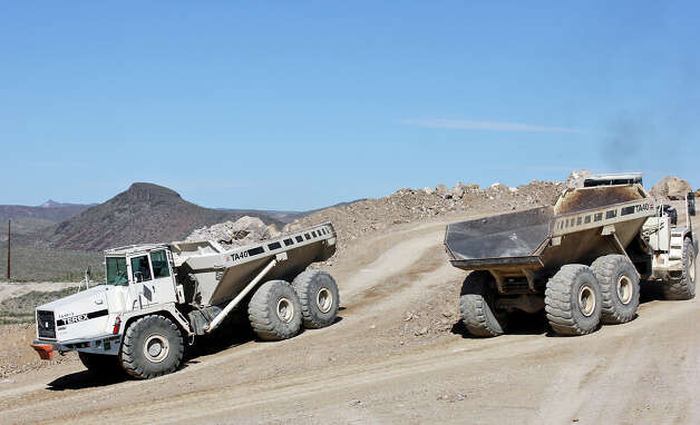 Workers use heavy equipment vehicles to remove waste rock from the Rio Grande Mining Co. Shafter Silver Mine site Oct. 19, 2012 in Shafter, Tx. Photo: Edward A. Ornelas, San Antonio Express-News / © 2012 San Antonio Express-News