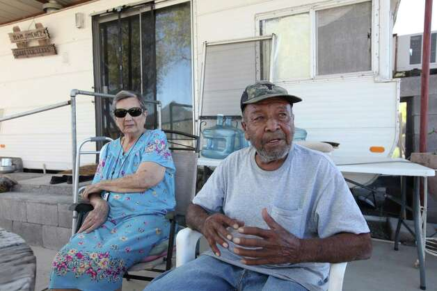 Mary, 84, (left) and Manny Jimenez, 89, answer questions at their home Oct. 19, 2012 in Shafter, Tx. Manny, who was born in Shafter, worked at the silver mine in 1940 for six months. Photo: Edward A. Ornelas, San Antonio Express-News / © 2012 San Antonio Express-News