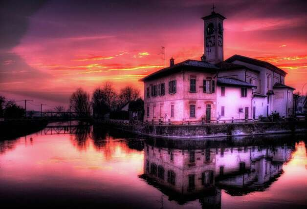 "Dusk decorates an ancient fortress near Milan with purplish colors in this Roberto Pagani photograph from ""Life in Color.""   Abbiategrasso, Italy Dusk decorates an ancient fortress near Milan with color. Photo: Photo By Roberto Pagani/National"