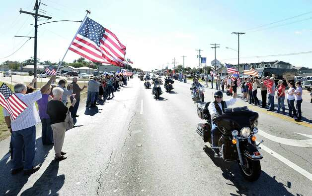 Hundreds gather on Nederland Avenue on Friday, November 9, 2012, to welcome home Sergeant Joshua Yarbrough as he is escorted by the Patriot Guard Riders to his home in Port Arthur.  The marine had suffered a severe injury while leading his men on a routine patrol in Afghanistan when an IED was blown.  Photo taken: Randy Edwards/The Enterprise