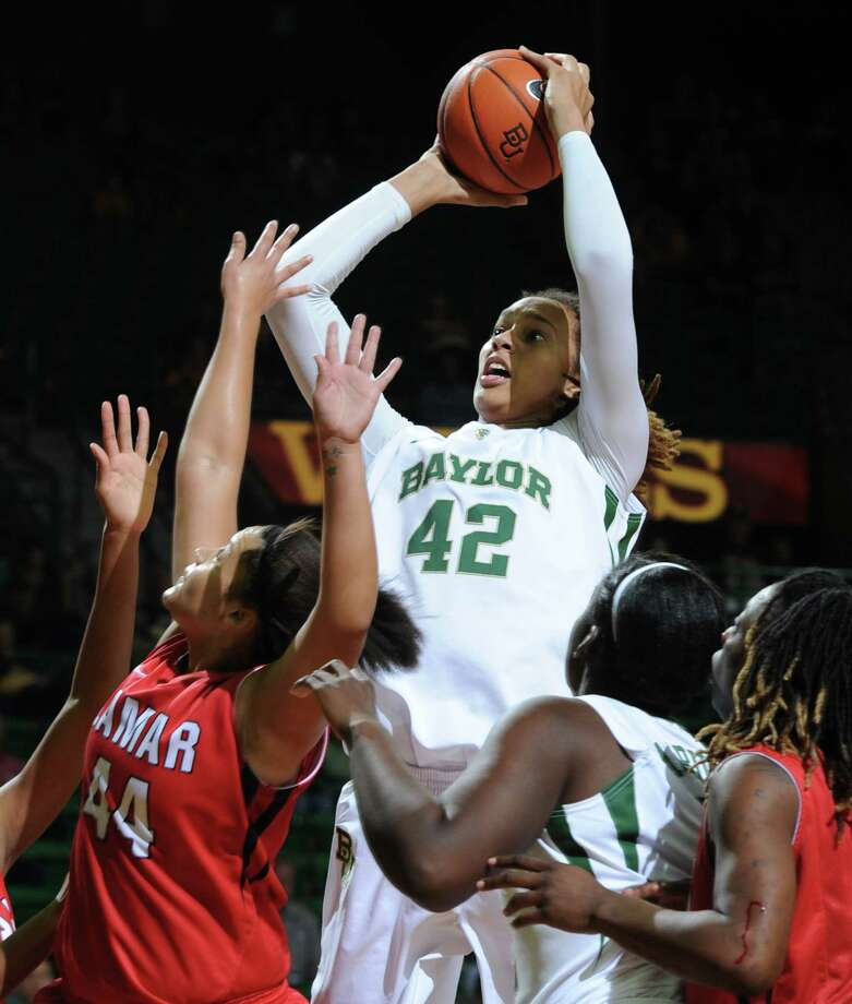 Baylor's Brittney Griner (42) shoots over Lamar's Kristina Higgins, left, during the second half of an NCAA college basketball game, Friday, Nov. 9, 2012, in Waco, Texas. Baylor won 80-34. (AP Photo/Waco Tribune Herald, Rod Aydelotte) Photo: Rod Aydelotte, MBO / Waco Tribune Herald
