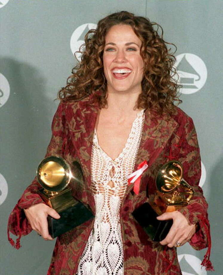 Sheryl Crowalso turned 50 this year, on Feb. 11. She's pictured in 1995, after her two big Grammy wins.  Photo: DAN GROSHONG, Getty Images / AFP