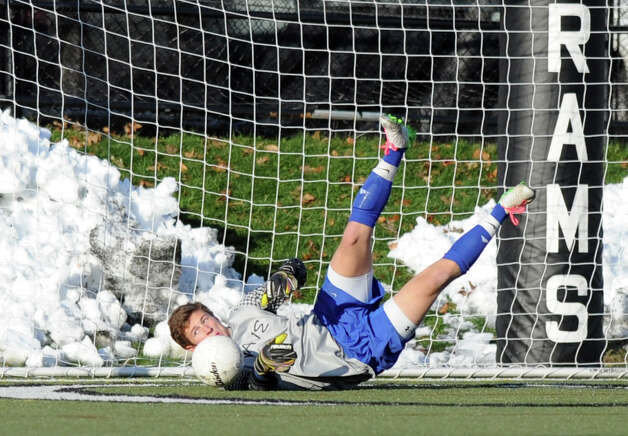 Darien's Jack Fisher makes a save during Friday's soccer game at New Canaan High School on November 9, 2012. Photo: Lindsay Niegelberg / Stamford Advocate