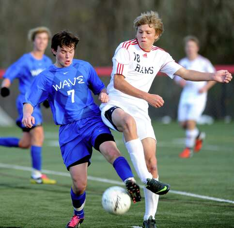 Darien's Jonathan Gill, left, and New Canaan's Eben Jones, right, compete for controls of the ball during Friday's soccer game at New Canaan High School on November 9, 2012. Photo: Lindsay Niegelberg / Stamford Advocate