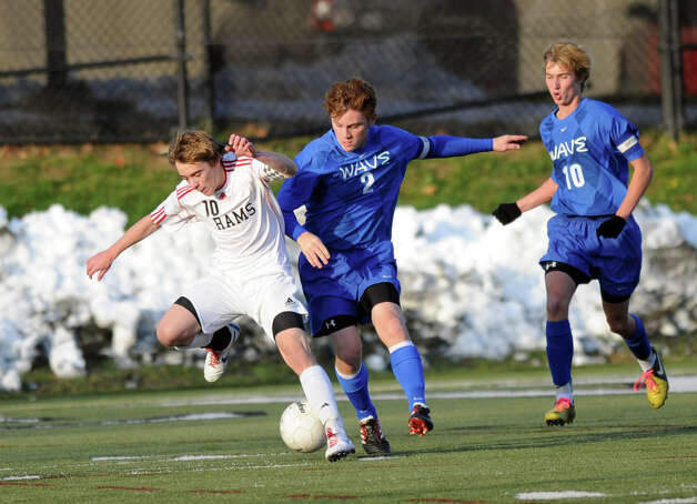 New Canaan's Steven Valente, left, and Darien's Brennan Branca, right, compete for controls of the ball during Friday's soccer game at New Canaan High School on November 9, 2012. Photo: Lindsay Niegelberg / Stamford Advocate