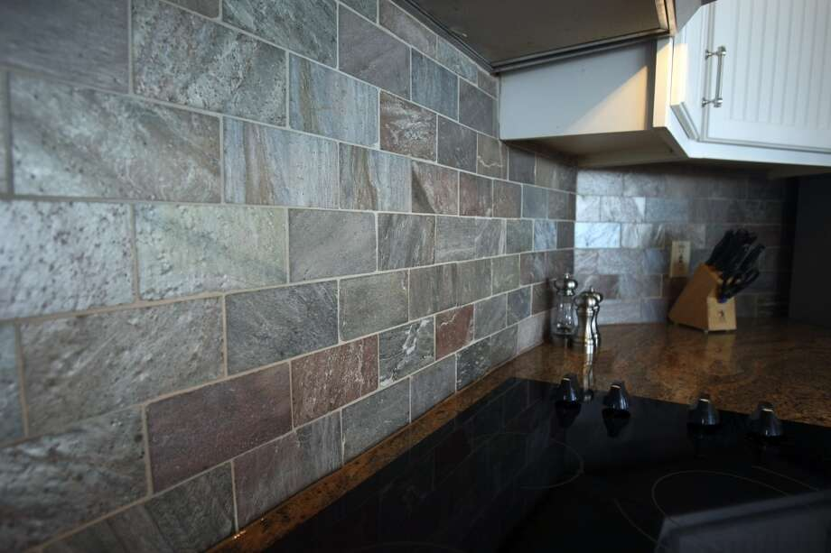 The kitchen backsplash is a tile with a metallic sheen.  Fischer, TX home of Jimmy Franklin, photographed Tuesday Nov. 6, 2012. (San Antonio Express-News)