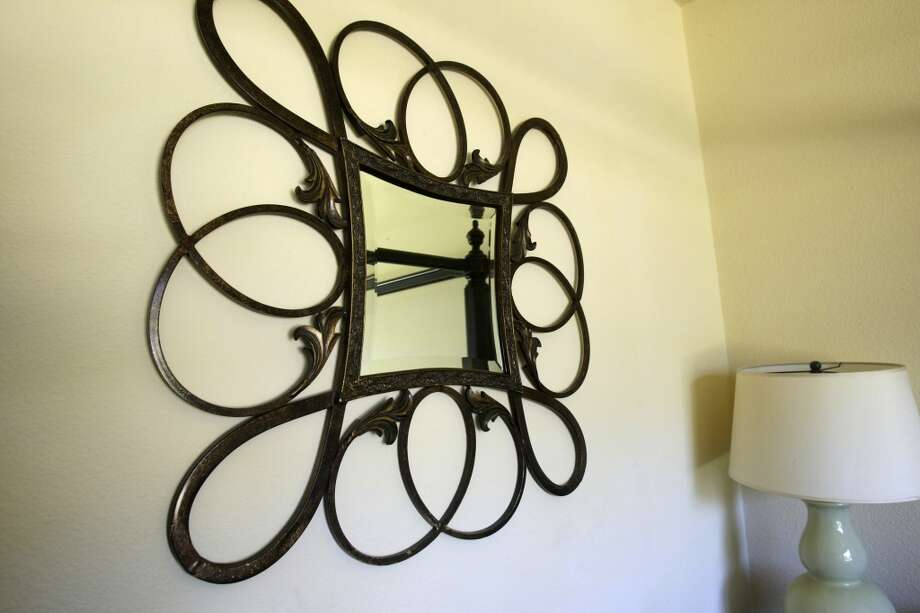 Wrought iron mirror adorns the guest bedroom wallk. Fischer, TX home of Jimmy Franklin, photographed Tuesday Nov. 6, 2012. (San Antonio Express-News)