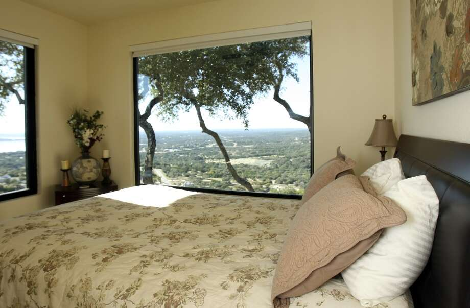 Guest bedroom offers a large picture window. Fischer, TX home of Jimmy Franklin, photographed Tuesday Nov. 6, 2012. (San Antonio Express-News)