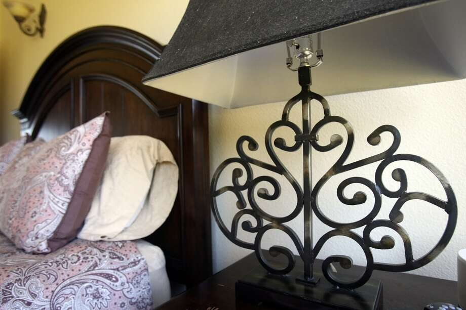 The iron lamps in the guest room are also seen throughout the other bedrooms of Jimmy Franklin's Fischer home, photographed Tuesday Nov. 6, 2012. (San Antonio Express-News)