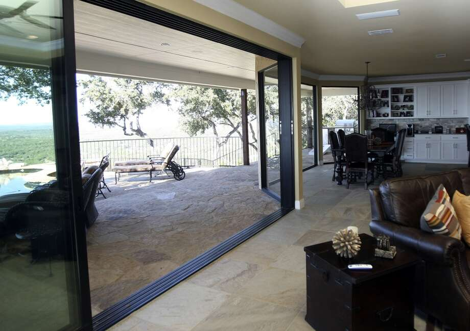 Sheet rock and the fire place were demolished to make way for sliding glass doors - total 18 feet in width  - that span width of living area. The windows and sliding glass doors were found and suggested by Franklin's architect Pax Chagnon of San Marcos, photographed Tuesday Nov. 6, 2012. (San Antonio Express-News)