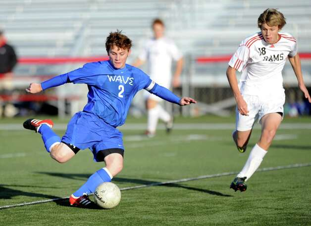 Darien's Brennan Branca controls the ball during Friday's soccer game at New Canaan High School on November 9, 2012. Photo: Lindsay Niegelberg / Stamford Advocate