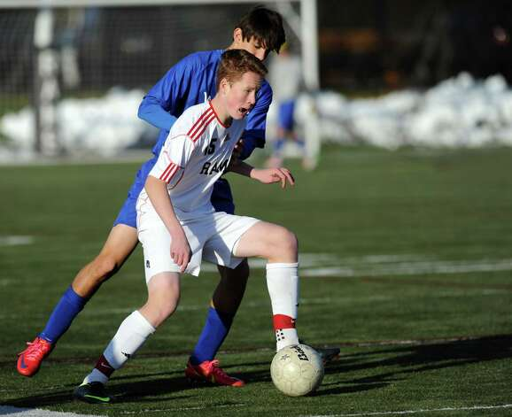 New Canaan's Alex Robey controls the ball during Friday's soccer game against Darien on November 9, 2012. Photo: Lindsay Niegelberg / Stamford Advocate
