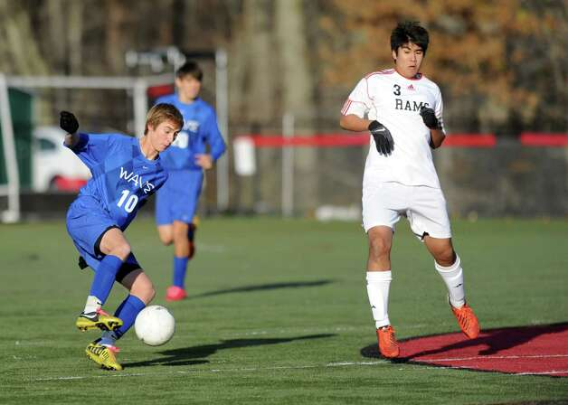 Darien's Ben Highton controls the ball during Friday's soccer game at New Canaan High School on November 9, 2012. Photo: Lindsay Niegelberg / Stamford Advocate