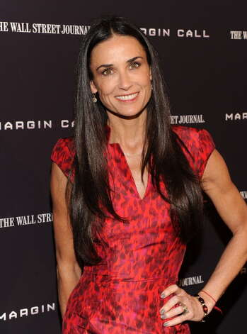 "Demi Moore appears solo at the Oct. 17, 2011 premiere of the movie ""Margin Call"" in a photo that prompted much talk about her gaunt appearance and health.  Photo: Jason Kempin, Getty Images / 2011 Getty Images"