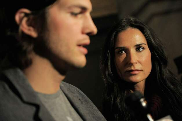 "Here's one of the last photos of Demi Moore and Ashton Kutcher together, before their high-profile split late last year. They're pictured on the April 14, 2011 campaign against child sex trafficking, called ""Real Men Don't Buy Girls.""  Photo: Jemal Countess, Getty Images / 2011 Getty Images"