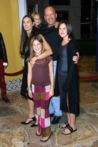 "Moore and Bruce Willis with daughters Rumer (R), Scout (center) and Tallulah (back) at the 2001 premiere of ""Bandits.""  Photo: Jason Kirk, Getty Images / Getty Images North America"