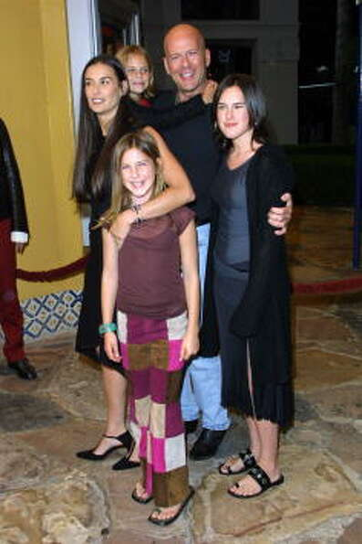 Moore and Bruce Willis with daughters Rumer (R), Scout (center) and Tallulah (back) at the 2001 prem