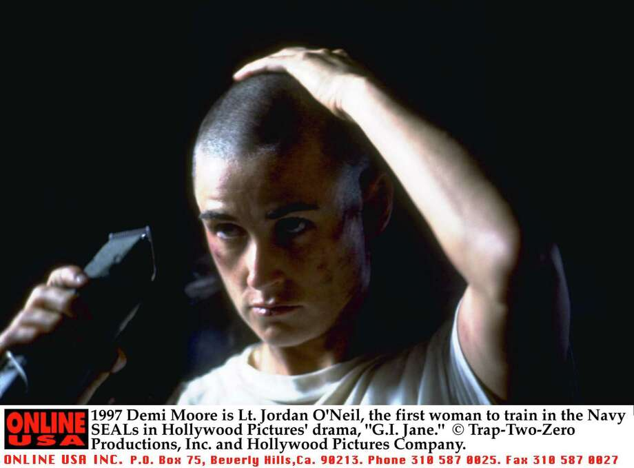 ".... shaved her head to play the wooden, but tough Lt. Jordan O'Neil in the 1997 movie ""G.I. Jane"" (starring a pre-Aragorn Viggo Mortensen).  Photo: Getty Images / Getty Images North America"