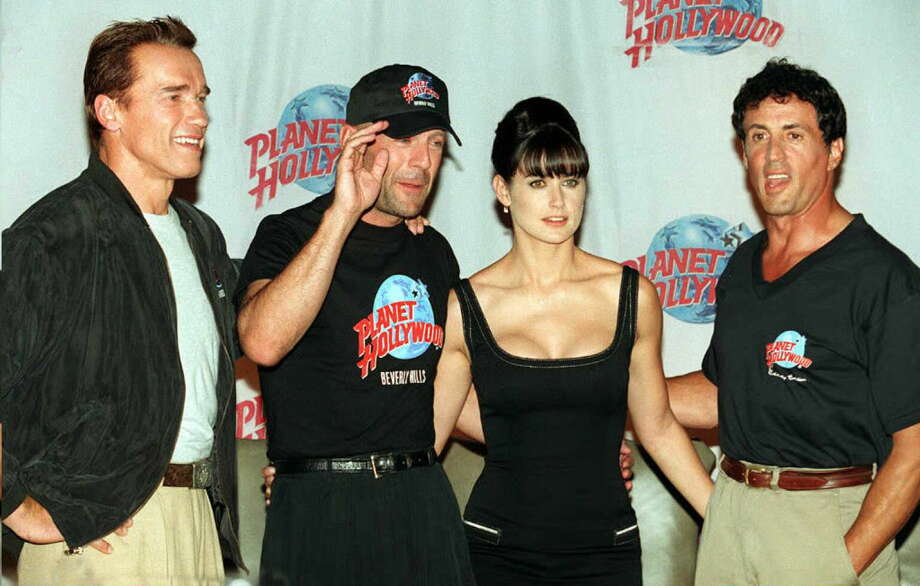 Here's Demi at the 1995 opening of Planet Hollywood in Beverly Hills, a chain financially backed by Demi Moore, Bruce Willlis (second left), Arnold Schwarzenegger (L) and Sylvester Stallone (R).  Photo: Vince Bucci, Getty Images / AFP