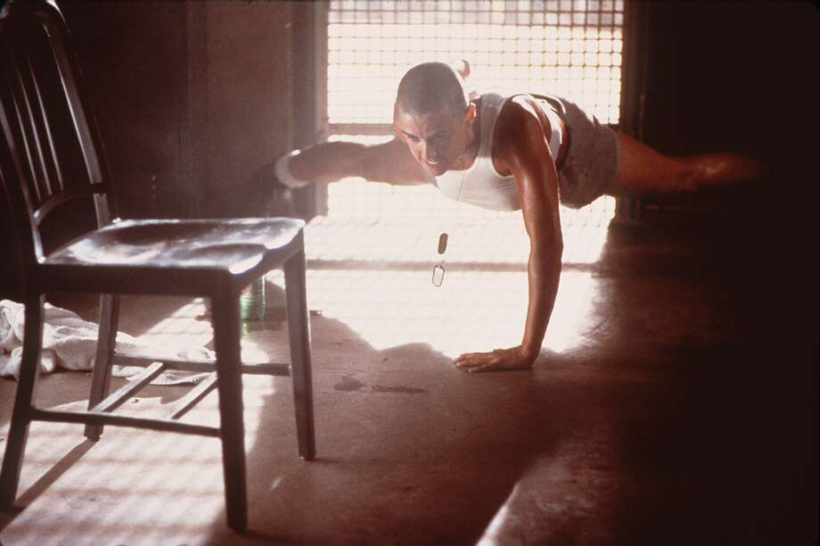 """Doing some one-handed push-ups in """"G.I. Jane.""""  Photo: PHIL BRAY   HOLLYWOOD PICTURES, File"""