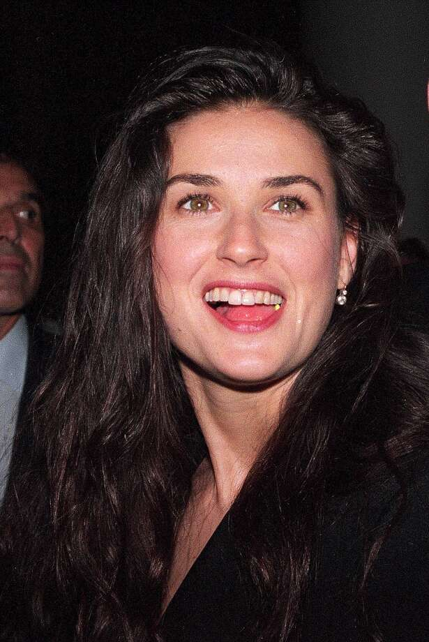 "Demi Moore in 1995, at the premiere of ""Die Hard With a Vengeance,"" starring then-husband Bruce Willis. They filed for divorce in 2000.  Photo: CLARK JONES, File / AP"
