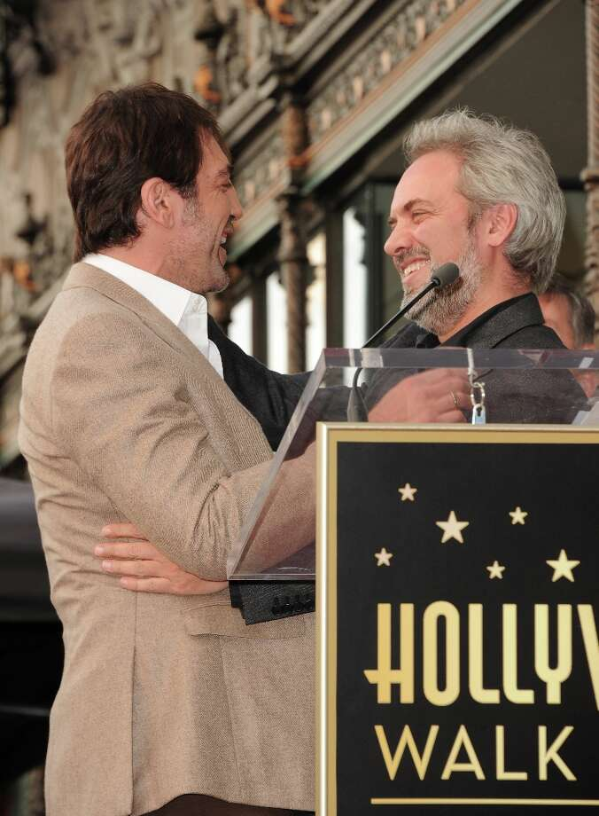 Actor Javier Bardem and director Sam Mendes pose for a picture as Javier Bardem is honored with a star on the Hollywood Walk Of Fame held on November 8, 2012 in Hollywood, California. Photo: Jason Merritt, Getty Images / 2012 Getty Images
