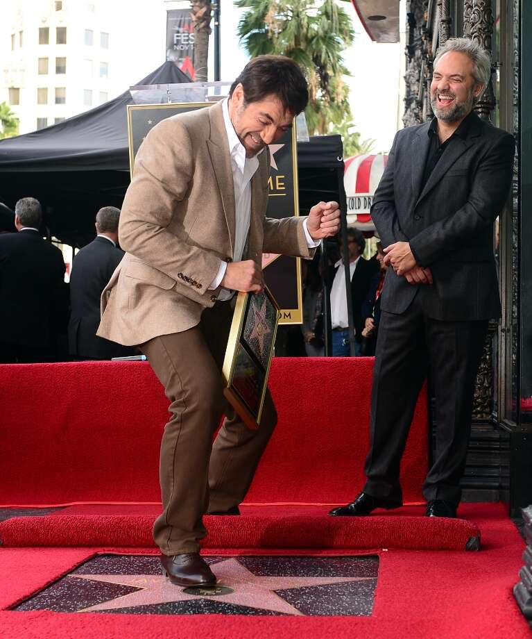 Actor Javier Bardem (L) steps on his Star on the Hollywood Walk of Fame on November 8, 2012 in Hollywood, California, as director Sam Mendes (R) laughs. Photo: FREDERIC J. BROWN, AFP/Getty Images / AFP