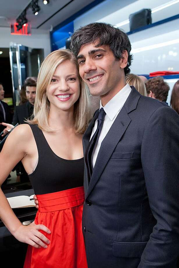"At the pre-birthday party and men's fashion fete at Dior Homme on Stockton Street in San Francisco Nov. 8, Yelp CEO Jeremy Stoppelman, right, fessed up that his girlfriend, Zoey Stafford, left, doesn't always like how he dresses. Although he cut a tidy figure in a slim Dior men's suit that night, Stoppelman sometimes wears a cardigan blazer made of heathered gray fabric. ""Guys love it, "" he said, ""but she is not as excited about it."" Photo: Drew Altizer Photography"