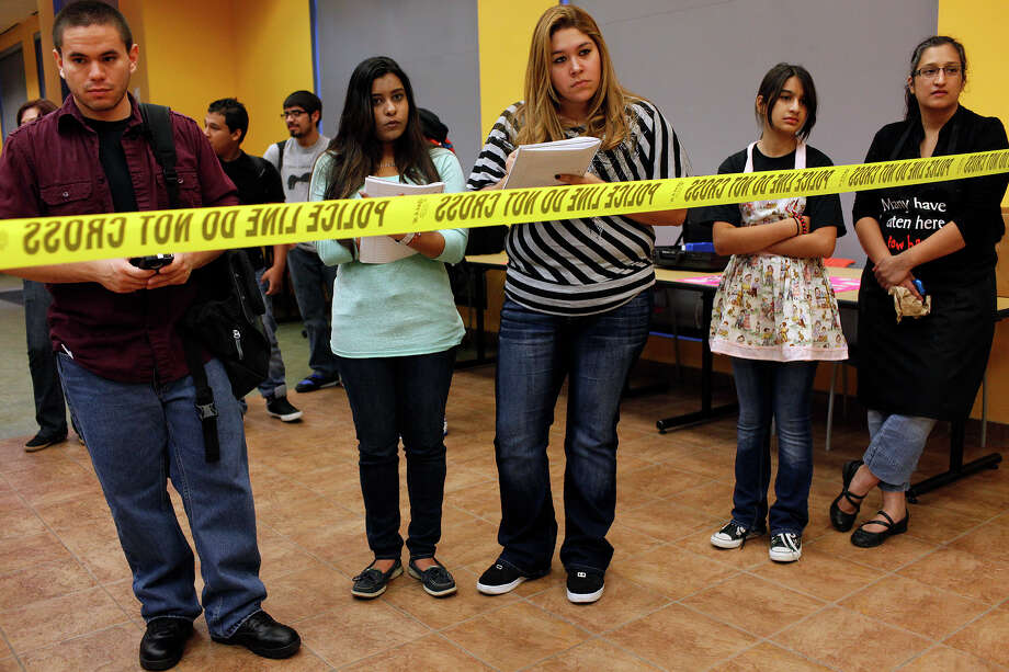 Palo Alto College Criminal Justice and Forensic Science  students, Charles Reyes, Bindia Patel and Jennifer Lara, take notes while they watch with Odelia Pena-Pathan, 11, and her mother, psychology student Maria Pena as criminal justice students investigate a staged homicide scene at the College's Student Center Annex on Friday, Nov. 9, 2012. Pena and her daughter did the makeup for the scene. (there is an enye over the n in pena) Photo: Lisa Krantz, San Antonio Express-News / © 2012 San Antonio Express-News