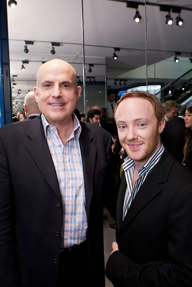 "Larry Block, left, who works at the Serge Sorokko Gallery, and jewelry designer Adam Neeley, attend the Dior Homme party for Details magazine and Jeremy Stoppelman of Yelp on Nov. 8 in San Francisco. Neeley said his signature style centers around coats with a long lapel and shoes with a strap, rather than laces. His fashion icon? Like almost every other man questioned that night, his answer was George Clooney. ""He's sexy, masculine and simply dressed. He pulls of the tux with long lapels beautifully."" Photo: Drew Altizer Photography"