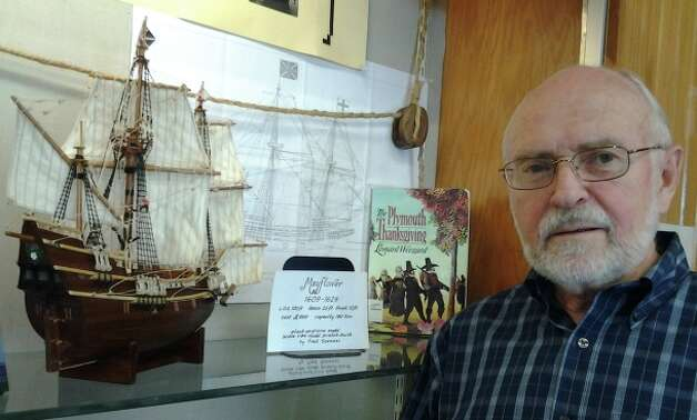 Fred Szenasi poses with the small-scale replica Mayflower ship model, which he hand-carved over 600 hours. That and a Mayflower ship-in-a-bottle, which Szenasi also crafted, are part of a Thanksgiving-themed display at Cody Library. Photo: Edmond Ortiz / North Central New