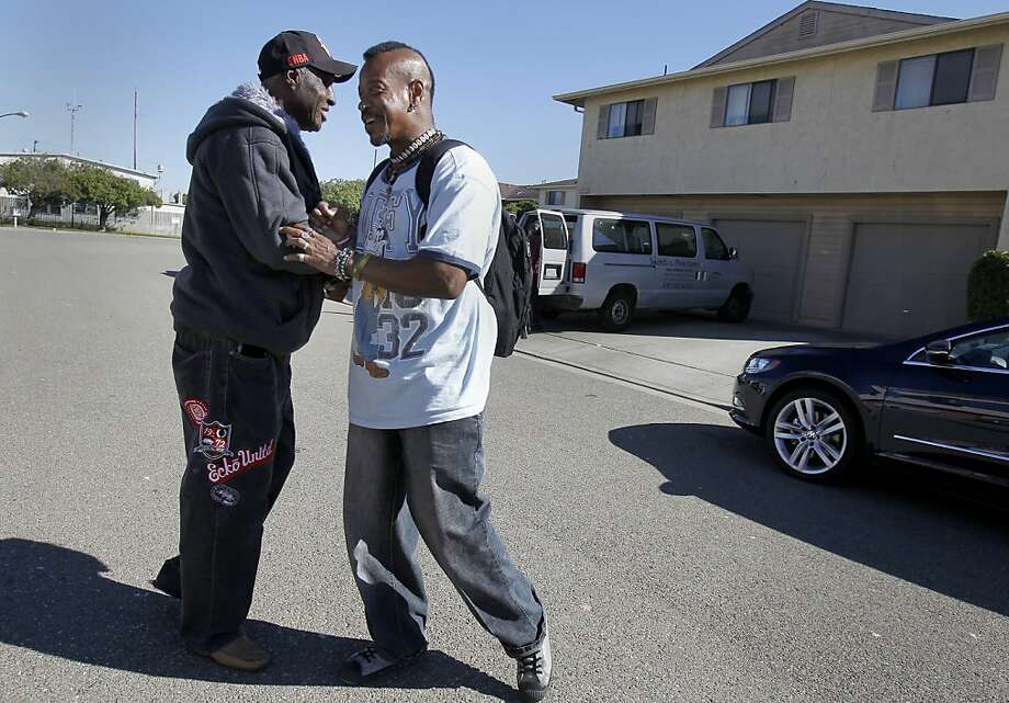 Veterans William Brown (left) and Ron Jones clown around in the street in front of their residences at Swords to Plowshare on Treasure Island. Dozens of veterans are waiting to move into a new facility on Otis Street in San Francisco, Calif. called Veterans Commons sponsored by Swords to Plowshares. Photo: Brant Ward, The Chronicle