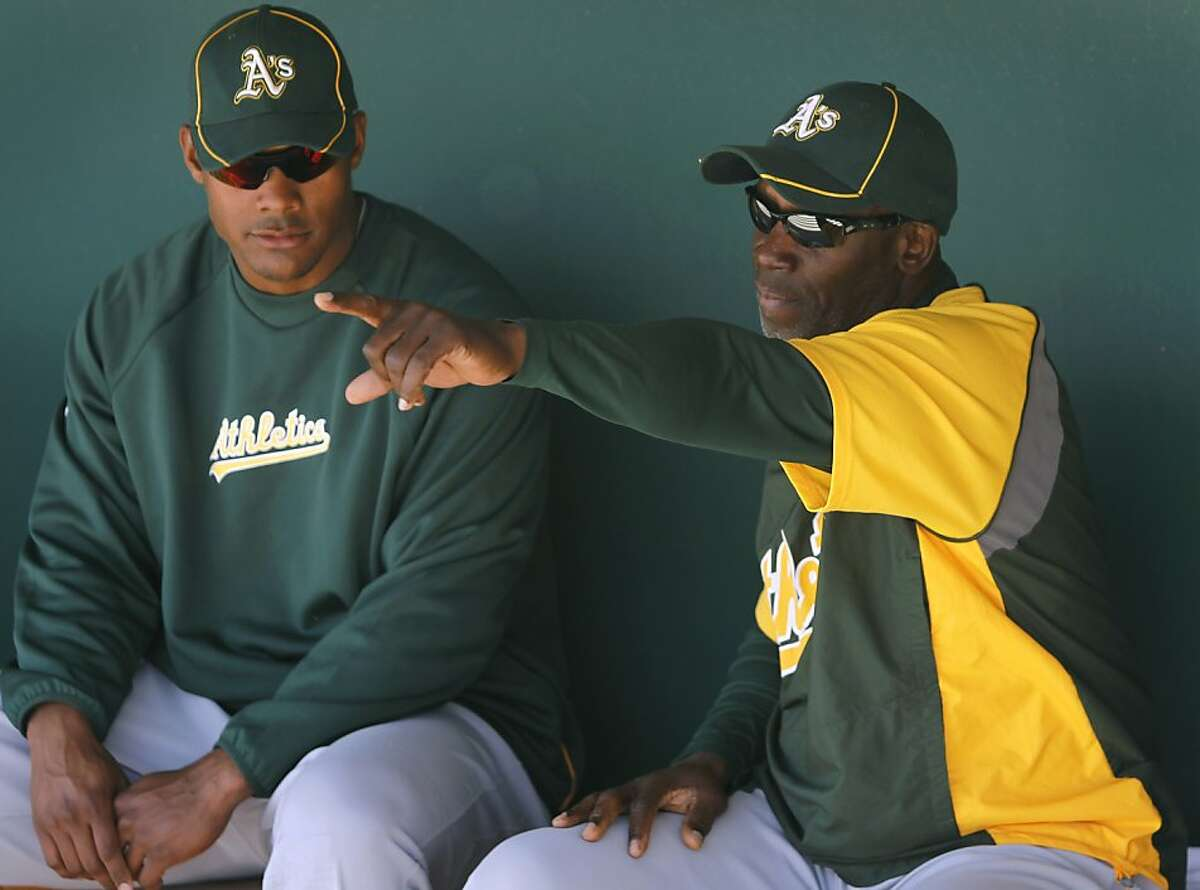 A's hitting coach Chili Davis (right) works with prospect Cedric Hunter during spring training in Glendale, Ariz. Davis is back in the Bay Area after playing for the Giants in the 1980s.