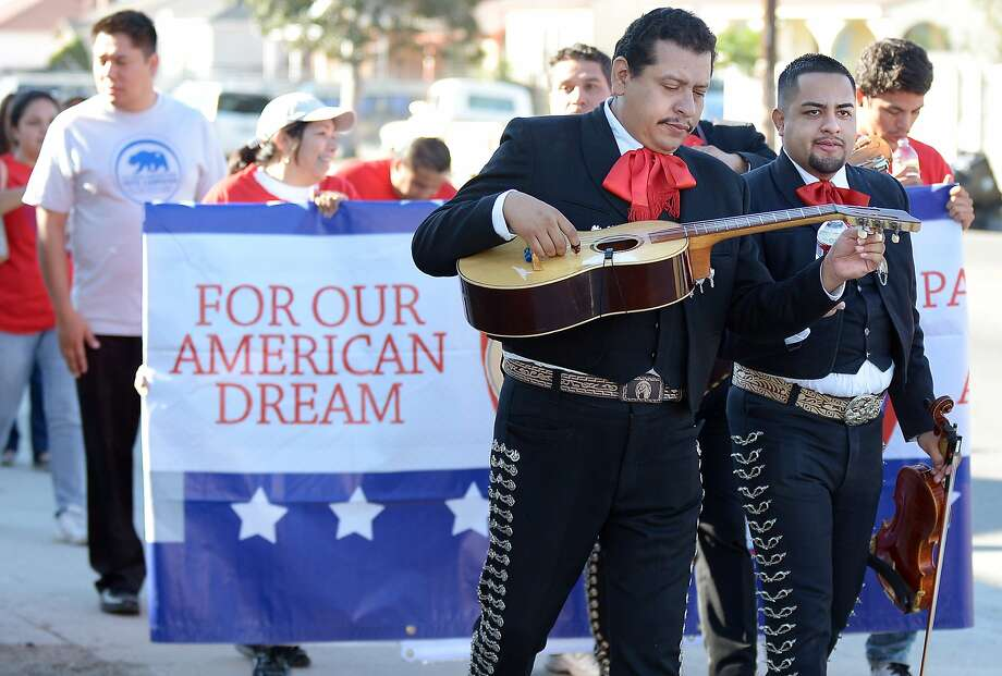 Mariachi musicians sing and play serenadEs as they go from house to house to encourage people to come to vote on election day in the predominantly Latino Sun Valley district of Los Angeles on November 6, 2012. From Mexican Americans and Puerto Ricans to Cuban Americans, the more than 12 million Hispanic Americans eligible to vote could hold the keys to the White House. Photo: Joe Klamar, AFP/Getty Images