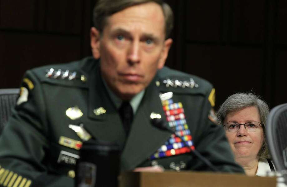 FILE - NOVEMBER 9, 2012: David Petraeus submitted his resignation as director of the CIA on November 9, 2012 citing an extramarital affair. WASHINGTON - JUNE 23:  U.S. Gen. David Petraeus (L) listens as his wife Holly Petraeus (R) looks on during a confirmation hearing before the Senate (Select) Intelligence Committee June 23, 2011 on Capitol Hill in Washington, DC. Gen. Petraeus will become the director of the Central Intelligence Agency if confirmed. Photo: Alex Wong, Getty Images File Photo / 2011 Getty Images