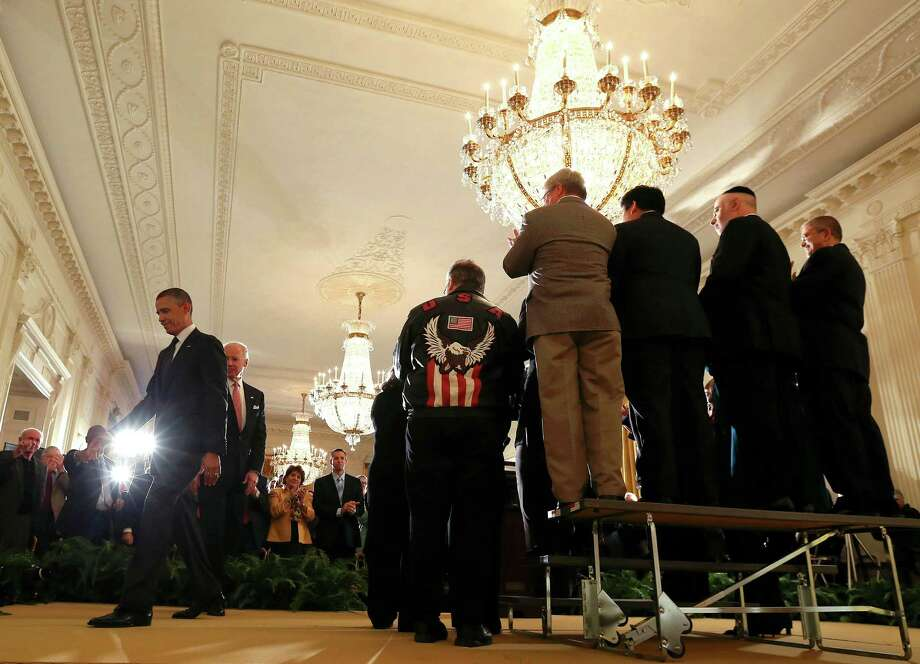 President Barack Obama (left) and Vice President Joe Biden leave a news conference at the White House. Obama said Friday that if a bipartisan deal wasn't reached on the so-called fiscal cliff, taxes on all Americans would increase Jan. 1, 2013. Photo: DOUG MILLS, New York Times / NYTNS