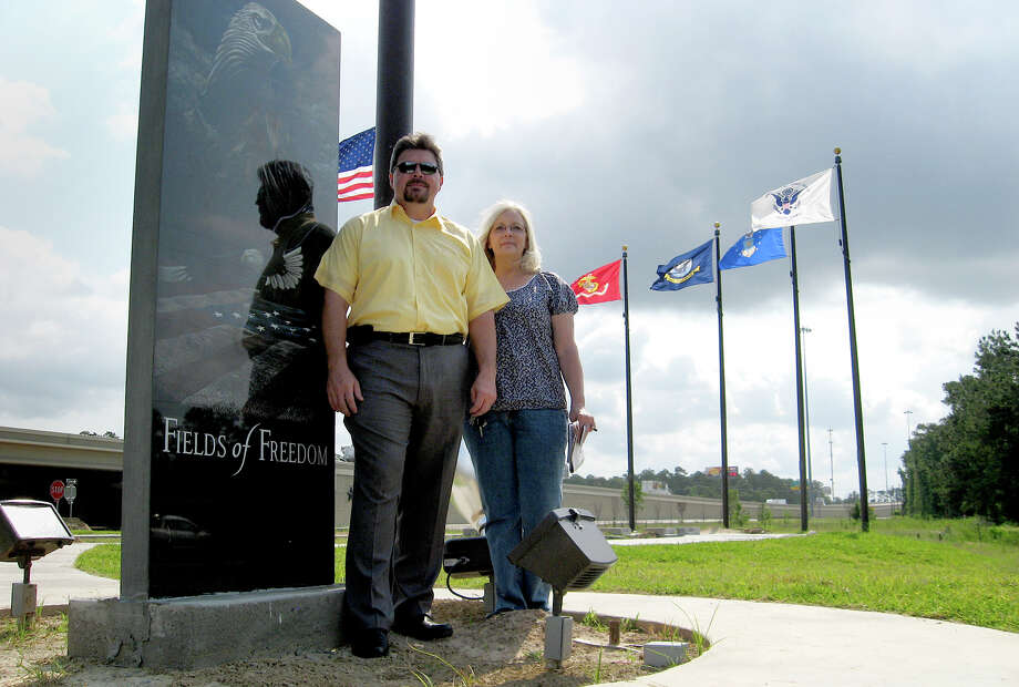 Derrick Bolt and Joanne Ledger, of the Vidor Lions Club, stand at Fields of Freedom veterans' memorial being built along Interstate 10 in Vidor. The park will be completed and dedicated in November. The club is accepting names of veterans through June for the memorial walls that will be installed. Amy Moore/The Enterprise